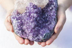 A piece of beautiful Amethyst in Hands royalty free stock photo