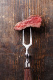 Piece of beef steak on meat fork Royalty Free Stock Photo