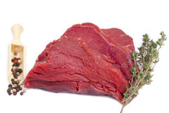 Piece Beef Tenderloin with a twig Thyme and Peppercorns Stock Image
