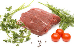 Piece of beef and vegetables on white Stock Photo