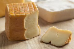 Piece of Belgian Limburger cheese. On a cheese board Royalty Free Stock Photos