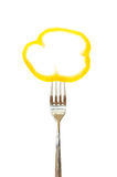 Piece of a bell pepper pinned on a fork Stock Image