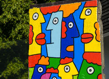 Piece of Berlin Wall with colorful graffiti Royalty Free Stock Images