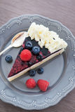 Piece of  berry cake decorated with whipped cream Royalty Free Stock Photography
