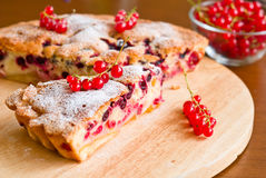 Piece of berry pie and red currants Royalty Free Stock Photos