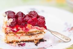 Piece of berry pie on saucer Stock Photos