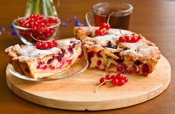 Piece of berry pie on saucer and tea Royalty Free Stock Photo