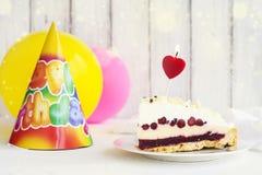 Piece of birthday cake Royalty Free Stock Photography