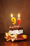 Piece of Birthday Chocolate Cake with Burning Candle as a Number Stock Image