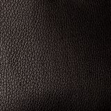 A piece of black artificial leather texture with highlight and g. Radient closeup Royalty Free Stock Photo
