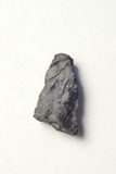 Piece of black coal Stock Images