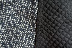 Piece of black polyester sewn to tweed. Fabric Royalty Free Stock Photography