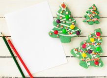 A Piece Of Blank Paper and Christmas Tree Cookies Stock Photography