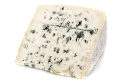 Piece of blue cheese. In front of white background royalty free stock image