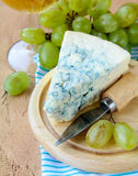 Piece of blue cheese with fruits Stock Photos