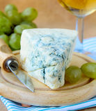 Piece of blue cheese with fruits Stock Image