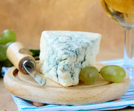 Piece of blue cheese with green grapes Stock Image