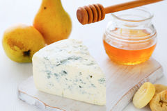 Piece of blue cheese and honey Royalty Free Stock Photo