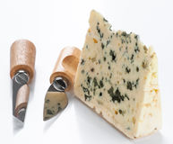Piece of blue cheese with knife Stock Image
