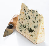 Piece of blue cheese with knife Stock Photos