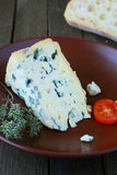 Piece of blue cheese on a plate Royalty Free Stock Photos