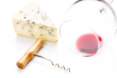 Piece of blue cheese with wineglass Royalty Free Stock Images