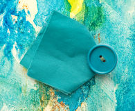 Piece of blue cloth with button Royalty Free Stock Photos