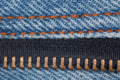 Piece of blue denim structure of line and zipper Royalty Free Stock Image