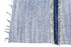 Piece of blue jeans fabric royalty free stock photos