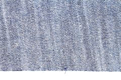 Piece of blue jeans fabric. Isolated on white background. Rough uneven edges. Denim pants torn. Wrong side of fabric stock photo