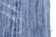 Piece of blue jeans fabric stock images