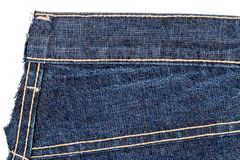 Piece of blue jeans fabric stock photography