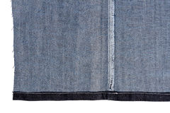 Piece of blue jeans fabric Royalty Free Stock Photography
