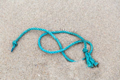 A piece of rope lies on a beach Stock Photos