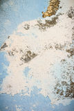 Piece of blue wall with plaster as a background Stock Image