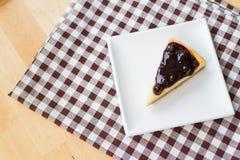 Piece of blueberry cheese pie Stock Photos