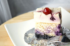 A piece of blueberry cheesecake Stock Photography