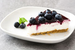 Piece of blueberry cheesecake Stock Image