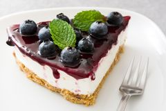 Piece of blueberry cheesecake. On gray stone Royalty Free Stock Images
