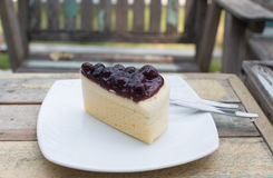 Piece of blueberry cheesecake. Royalty Free Stock Photography