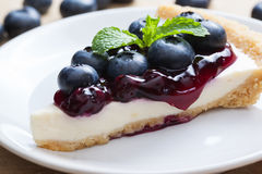 Piece of blueberry cheesecake on plate Royalty Free Stock Photos