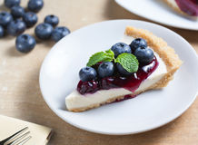 Piece of blueberry cheesecake on plate Royalty Free Stock Image