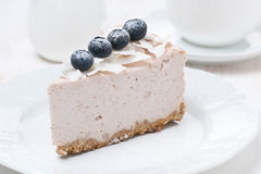 A piece of blueberry and coconut cheesecake Royalty Free Stock Images