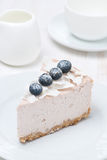 A piece of blueberry and coconut cheesecake, vertical Stock Photography