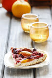 Piece of blueberry, peach and plum cake Royalty Free Stock Photo