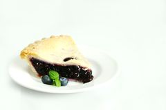 Piece of blueberry pie Stock Image