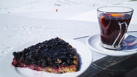 Piece of blueberry pie, hot red wine, in apres ski bar in Alps Royalty Free Stock Photos