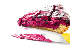 A piece of blueberry pie and knife isolated Stock Images