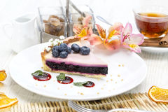 Piece of blueberry pie. On a table in a restaurant stock photography