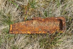 Piece of bombshell from second world war. Splinter bomb left in the field Stock Images